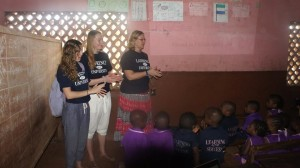 Professor Claudena Skran and KidsGive volunteers presenting the videos to students in Sierra Leone