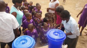 Students in Sierra Leone practice hand washing after watching the video